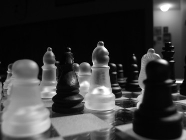 dark image of a chess set