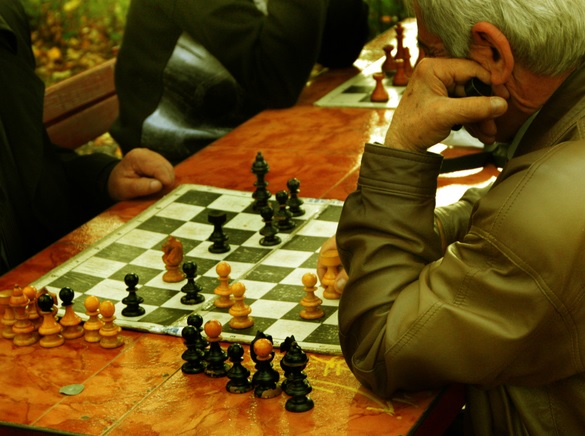 man concentrates on a chess move