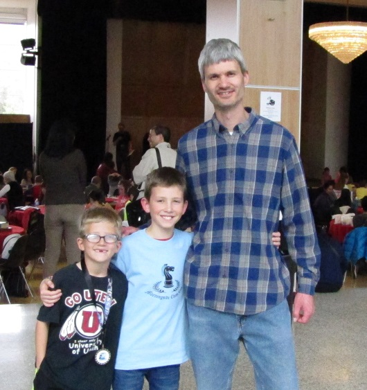 Matt with his two sons, after the tournament
